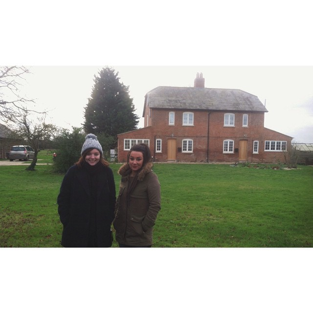 Outside my childhood house with my childhood best friend